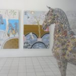 two paintings and horse sculpture