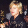 Closeup of Ellen DeGeneres holding an Emmy award