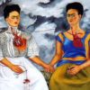 Two Frida Kahlo's painted sitting next to one another with hearts exposed and connected via veins