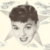 Judy Garland in black and white advertisement, shown with a closeup cut of her face over a star in the sky